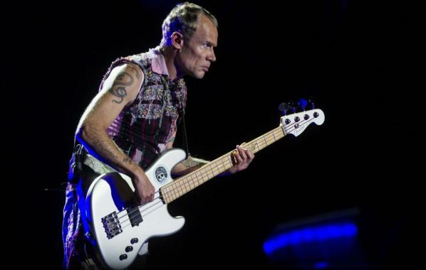 NME Festival blog: Red Hot Chili Peppers' Flea entertains crowd with handstands as band's show cuts out after one song