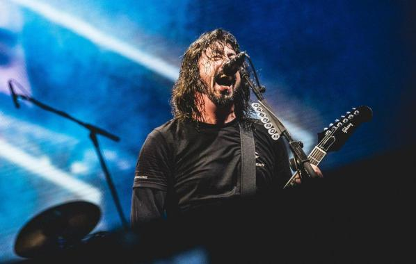 NME Festival blog: Watch Dave Grohl invite crowdsurfing Foo Fighters fan in wheelchair on stage at Sziget 2019